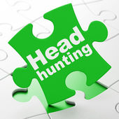 Finance concept: Head Hunting on puzzle background — Stock Photo