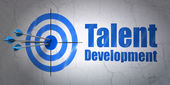 Education concept: target and Talent Development on wall background — Stock Photo