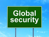 Safety concept: Global Security on road sign background — Stockfoto