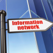 Foto Stock: Information concept: sign Information Network on Building background