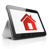 Finance concept: Home on tablet pc computer — Stock Photo