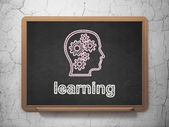Education concept: Head With Gears and Learning on chalkboard background — Stockfoto