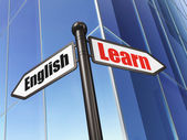 Education concept: sign Learn English on Building background — Stock Photo