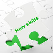Education concept: New Skills on puzzle background — Stock Photo