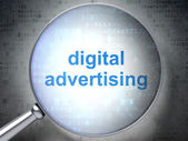 Marketing concept: Digital Advertising with optical glass — Stock Photo