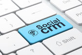 Business business concept: Head With Gears and Social CRM on computer keyboard background — ストック写真