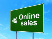 Advertising concept: Online Sales and Calculator on road sign background — Stock Photo