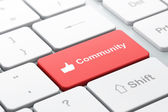 Social network concept: Thumb Up and Community on computer keyboard background — Stock Photo