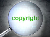 Law concept: Copyright with optical glass — Stock Photo