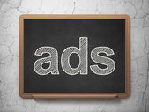 Advertising concept: Ads on chalkboard background — Stock Photo