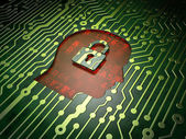 Information concept: Head With Padlock on circuit board background — Stock Photo