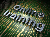 Education concept: Online Training on circuit board background — Stock Photo