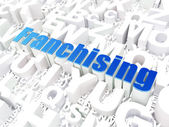 Business concept: Franchising on alphabet background — Stock Photo