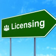 Law concept: Licensing and Business People on road sign background — Stock Photo #41664395