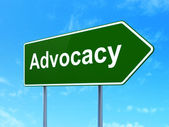 Law concept: Advocacy on road sign background — Stock Photo