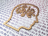 Education concept: Golden Head With Finance Symbol on Alphabet background — Stock Photo