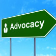 Law concept: Advocacy and Business Man on road sign background — Stock Photo