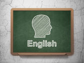 Education concept: Head and English on chalkboard background — Stock Photo