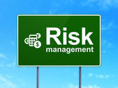 Finance concept: Risk Management and Calculator on road sign background — Stock Photo