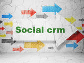 Finance concept: arrow with Social CRM on grunge wall background — Stock Photo