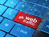 Web development concept: Gears and Web Traffic on computer keybo — Stock Photo