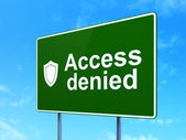 Privacy concept: Access Denied and Shield on road sign background — Stok fotoğraf