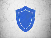 Privacy concept: Shield on wall background — 图库照片