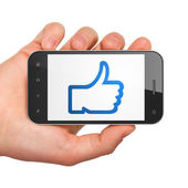Social network concept: Thumb Up on smartphone — Stock Photo