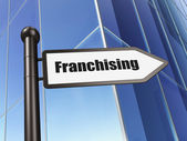 Finance concept: sign Franchising on Building background — Stock Photo