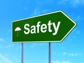 Privacy concept: Safety and Umbrella on road sign background — Stock Photo