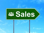 Marketing concept: Sales and Business People on road sign background — ストック写真