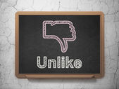 Social network concept: Thumb Down and Unlike on chalkboard background — Stock Photo
