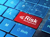 Business concept: Calculator and Risk Management on computer keyboard background — Stockfoto