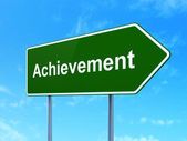 Education concept: Achievement on road sign background — Foto Stock
