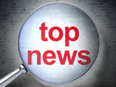 News concept: Top News with optical glass — Stock Photo