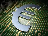 Koncept měny: euro na desce pozadí — Stock fotografie