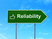 Business concept: Reliability and Thumb Up on road sign background — Foto de Stock