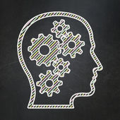 Advertising concept: Head With Gears on chalkboard background — Stock Photo