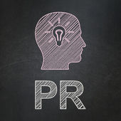Marketing concept: Head With Light Bulb and PR on chalkboard background — Foto de Stock