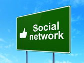 Social network concept: Social Network and Thumb Up on road sign background — Stock Photo