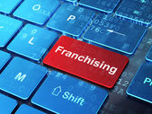 Business concept: Franchising on computer keyboard background — Stock Photo