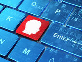 Information concept: Head on computer keyboard background — Stock Photo