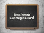 Finance concept: Business Management on chalkboard background — 图库照片