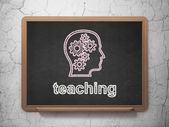 Education concept: Head With Gears and Teaching on chalkboard background — Stock Photo
