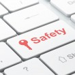 Protection concept: Key and Safety on computer keyboard background — Stock Photo #43350811