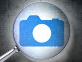 Vacation concept: Photo Camera with optical glass on digital background — Stock Photo