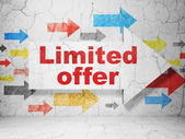 Business concept: arrow with Limited Offer on grunge wall background — Stockfoto
