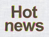 News concept: Hot News on fabric texture background — Stock Photo