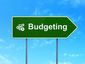 Finance concept: Budgeting and Calculator on road sign background — Photo