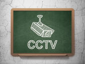 Safety concept: Cctv Camera and CCTV on chalkboard background — Stock Photo